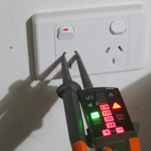 A photo of our electrician testing a power point